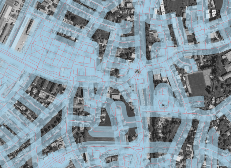 Image 6: Close-up of the 20m buffer around the roads, b/w satellite image in the background. The buffer is partially transparent in order to show the many overlapping features of the individual buffers.